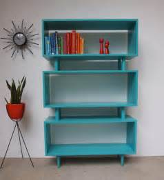 Aqua Bookshelf mcm turquoise shelves interior design midcentury decor furniture color aqua teal books