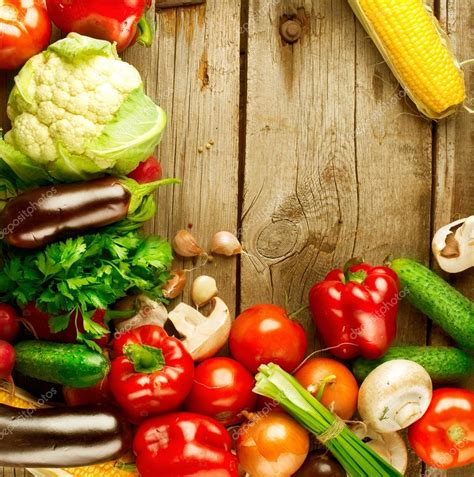 Healthy Organic Vegetables on a Wood Background ? Stock