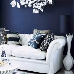 Midnight blue wall paint living room with dark feature wall living