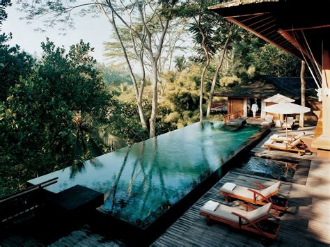 infinity pools bali como shambhala estate bali deckchairs and infinity pool with views interior design ideas
