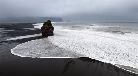 beach with black sand black sand beach iceland feel the planet