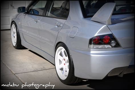 silver mitsubishi lancer black rims another silver 9 with white te37 18x9 5 22 evolutionm