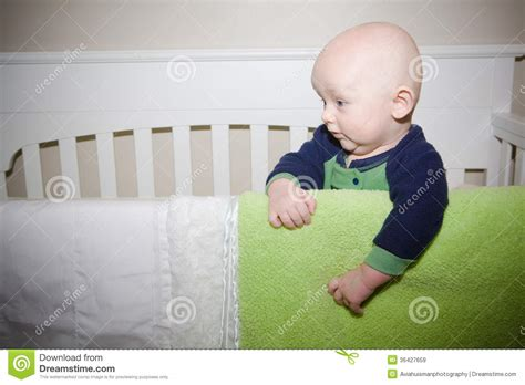 Baby Standing In Crib by Baby Standing In Crib Royalty Free Stock Images Image