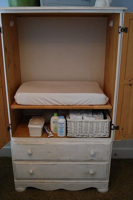 Changing Table Armoire by An Entertainment Center With Pull Out Shelf As A