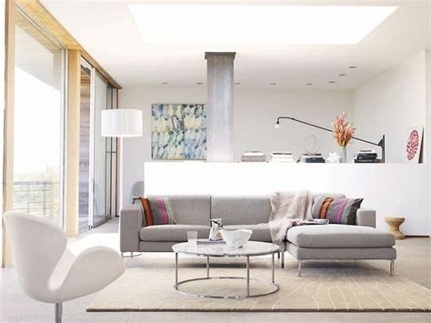 chaise prouvé neo sectional shown with swan chair dwr livingroom