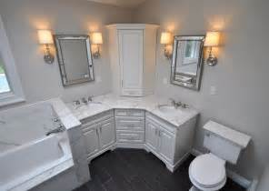 Corner Bathroom Vanities And Cabinets Custom Master Bathroom With Corner Vanity Tower Cabinet Wall Sconces Toilet And Built