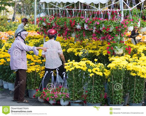 new year flower tradition at flower market before tet lunar new year editorial