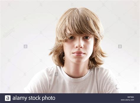12 year old boy with long hair from book infestation 12 year old boy looking into the camera stock photo