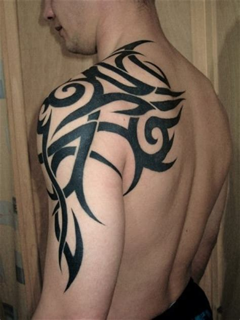 mens tribal shoulder tattoo genre of tattoos december 2010