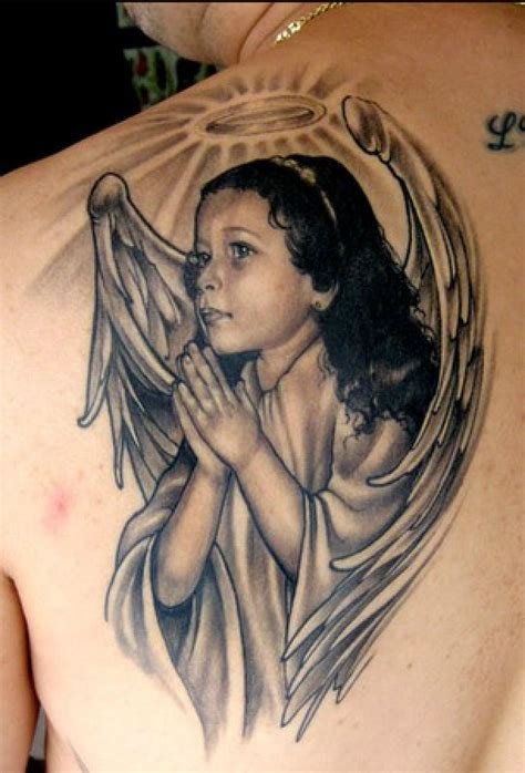 awesome realistic cherub with nimbus tattoo on