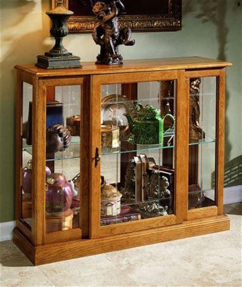 ashley furniture oak curio cabinet pulaski consoles