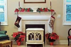 modern fireplace tools decorating a fireplace mantel for