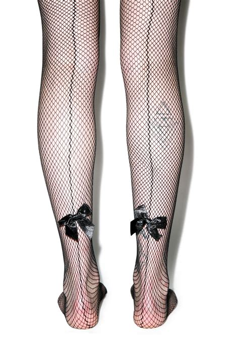 Bow Fishnet Tights j adore mon bow backseam fishnet tights dolls kill