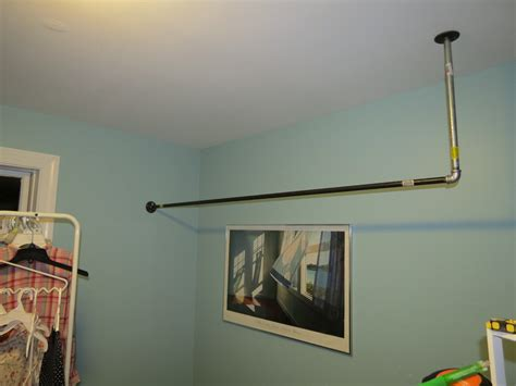 Hanging Clothes Rod From Ceiling 301 moved permanently