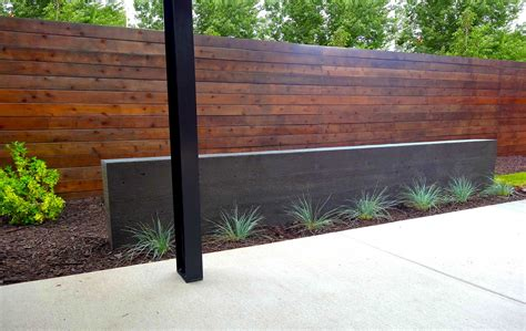 modern steel arbor and poured concrete water feature in