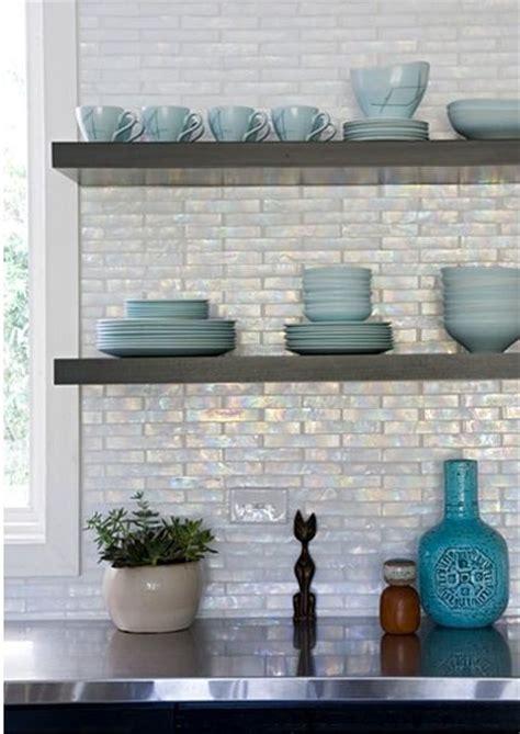 iridescent backsplash   ebony cabinets & floating shelves
