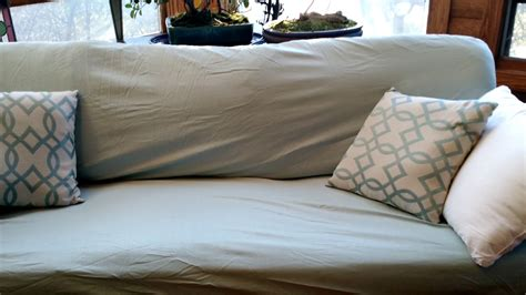what to look for in bed sheets cover a couch with bed sheets for a fresh clean look this