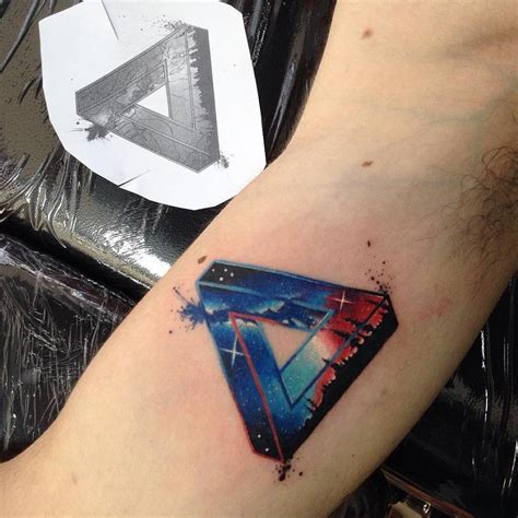galactic penrose triangle tattoo on the right inner