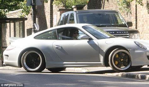 porche hairstyles pics pfanaticle harry styles and a porsche 911 sport classic