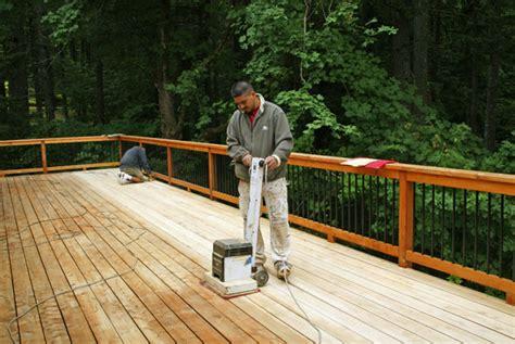 outdoor sanding a deck green tree sanding a deck