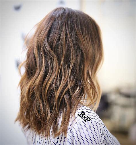 bayalage on medium layered hair wavy chestnut brown collarbone length hair with caramel