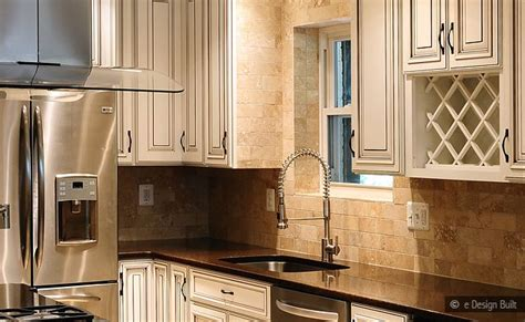 white cabinets with suede brown granite with backsplash