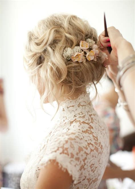 Wedding Updos With Flowers by 41 Trendy And Chic Wedding Hairstyles Weddingomania