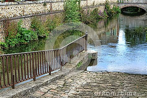 boat launch in french cobblestone boat launch r on old france canal stock