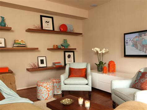 And Orange Living Room by White And Orange Living Room With Shelves Hgtv