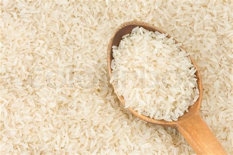 whole grain japanese rice rice grain andspoon stock photo colourbox