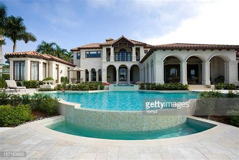 garden swimming pool custom dream homes snowy evening mansion stock photos and pictures getty images