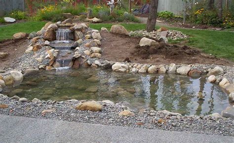 top 28 how to build a waterfall pond hometalk how to build pond waterfall and wall