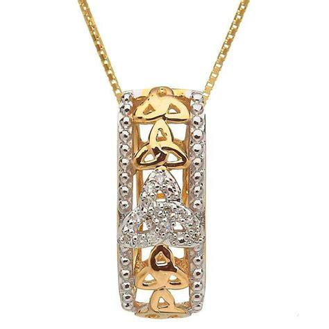 10 karat gold set knot pendant