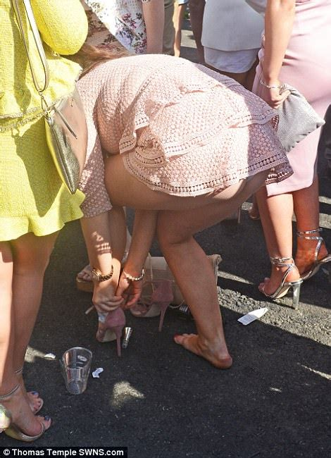 bent over short dress grand national racegoers dress to the nines for ladies day