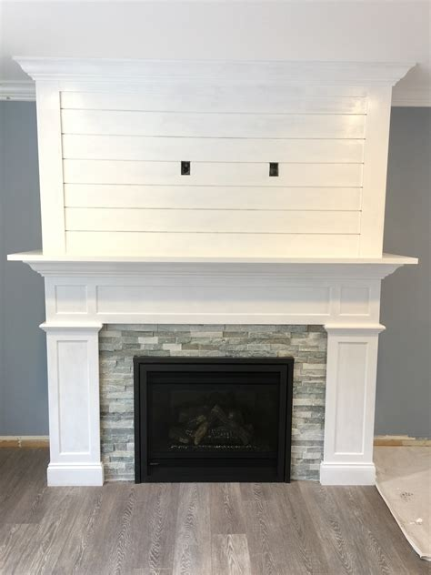 our craftsman style fireplace with shiplap mantel