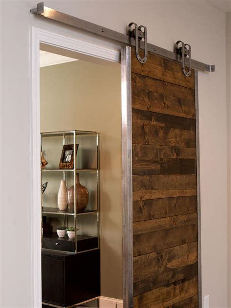 Barn Doors For Home Outstanding Reclaimed Wooden Single Sliding Barn Doors For Homes With Open Cabinetry Shelves As