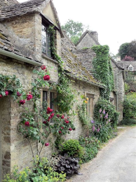 bibury cottages cotswold cottages covered with flowers content in a cottage