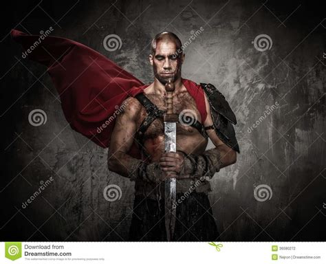wounded gladiator holding sword stock photography image