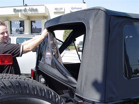 jeep soft top rear window bar go topless lowering the sunrider soft top on a 2007 jeep jk wrangler 4 door