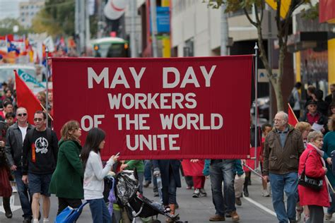 day by day come what may day by day may day workers of the world unite may day march in