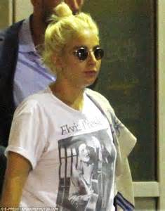 arriving in style lady gaga chose a vintage cadillac to take her to lady gaga pairs jeans with an elvis presley t shirt for