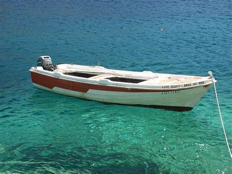 micro house boat small boat on green blue waters 1763 news zakynthos zante photos