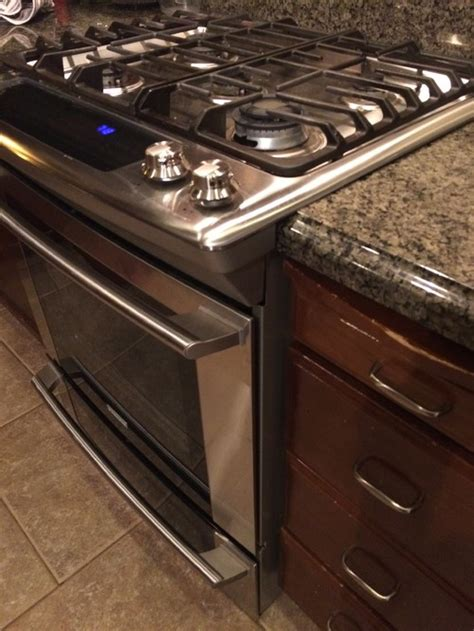 stove opening between cabinets slide in range dilemma with countertop advise