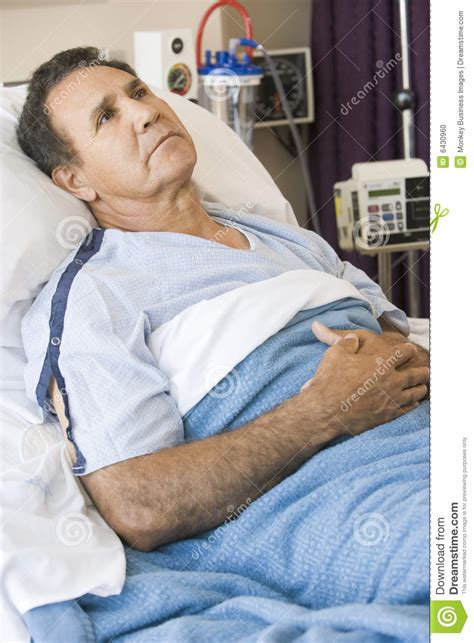 guy in hospital bed middle aged man lying in hospital bed stock photo image