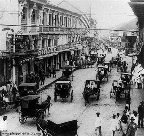 tattoo espana manila an old photograph of the bustling street of escolta in