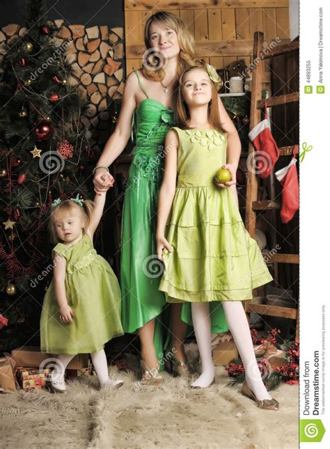 mother   daughters   green dress stock image