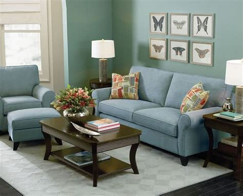 blue green wall  light blue couch create  relaxing