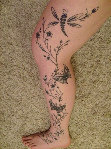 dragonfly and flowers tattoos leg
