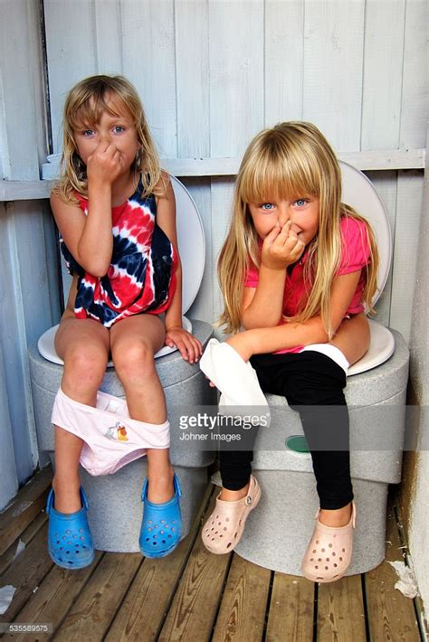 going to the bathroom naked girls sitting on toilets stock photo getty images