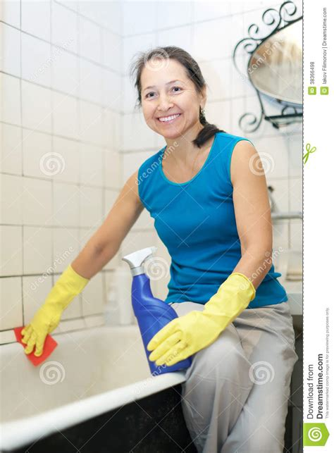 mature bathtub smiling mature woman cleans bathroom royalty free stock